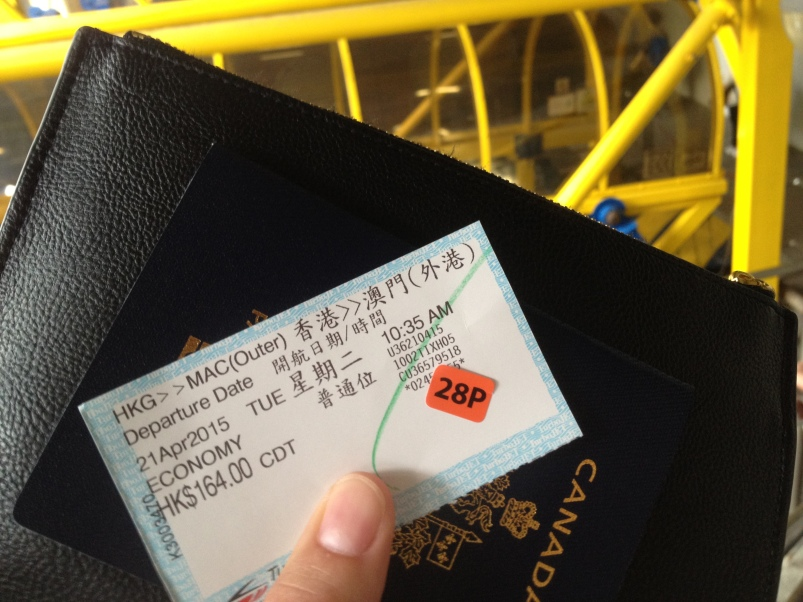 I'm ready to board the ferry, armed with my ticket, passport, and Work Visa stamp.