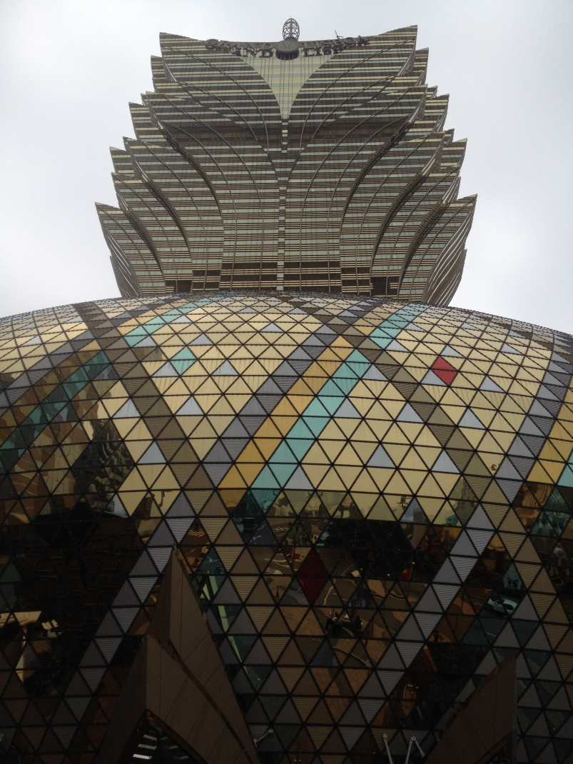Front facade of the Grand Lisboa, which reflect the surrounding similar to The Bean in Chicago