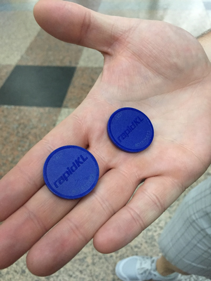 Our tokens for the train. You pre-pay for your exact destination. To get through the turnstile you put your token in and it spits it back. At your final destination you put your token in again to get out, and the turnstile keeps it.