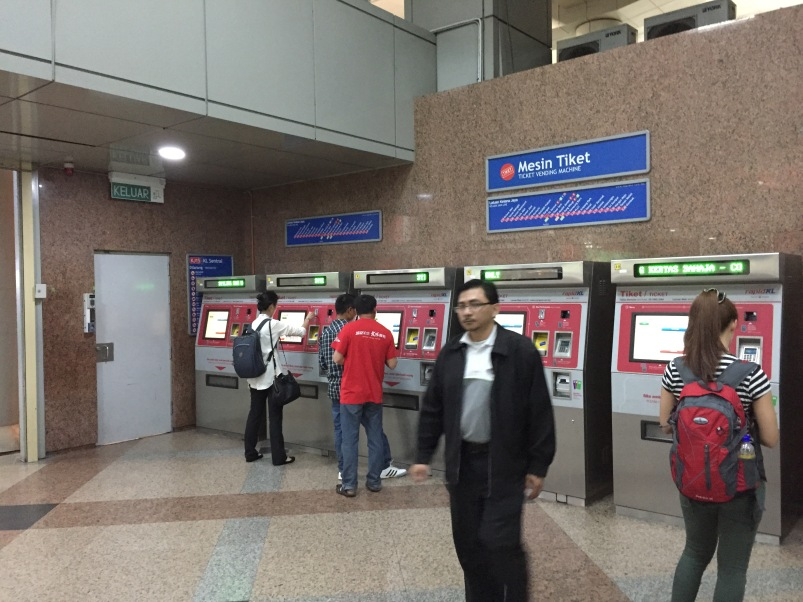 Purchasing tokens at the station.