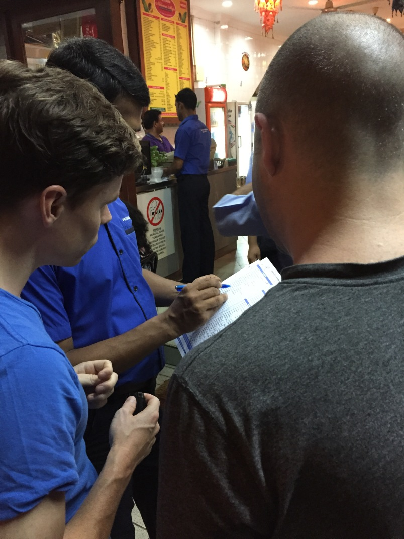 Braden and Daren deciding what to order. You make your decision before you're seated for maximum efficiency.