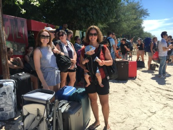 Waiting for our ferry in the sand.