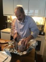 Braden's Dad carving our bird.