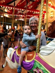 Doesn't look it, but very happy on the carousel!