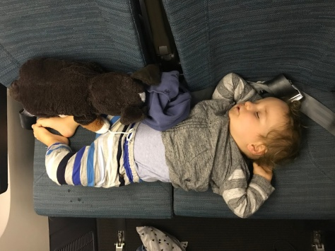 Finally asleep on our flight to Bali