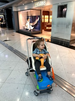 Our first stroller-less flight...thank goodness for these carts in the HK arirport